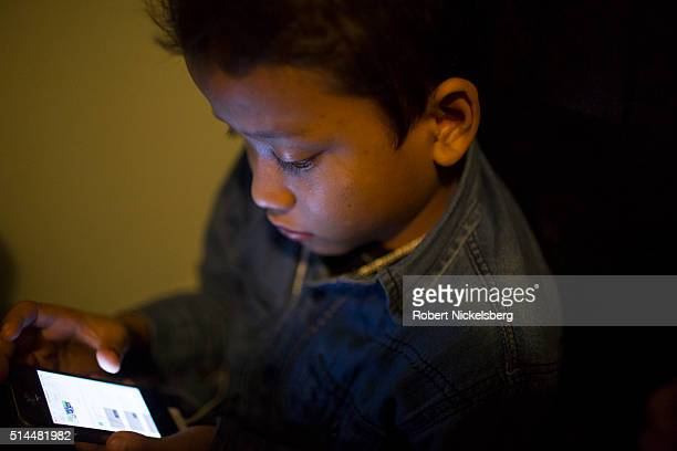 Closeup of Susan Gurung as he looks a smartphone screen Burlington Vermont January 5 2016 Members of the extended Gurung family moved to the...