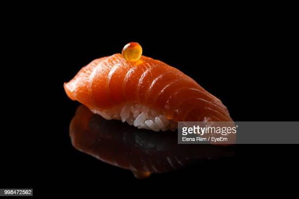 close-up of sushi against black background - japanese food stock pictures, royalty-free photos & images