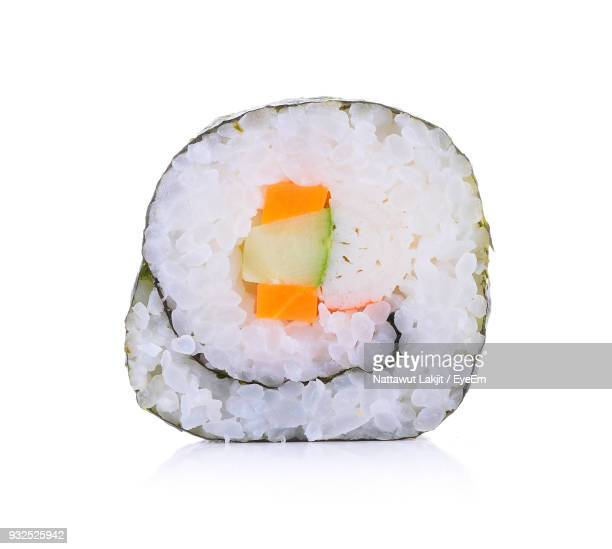 close-up of sushi against white background - sushi stock pictures, royalty-free photos & images