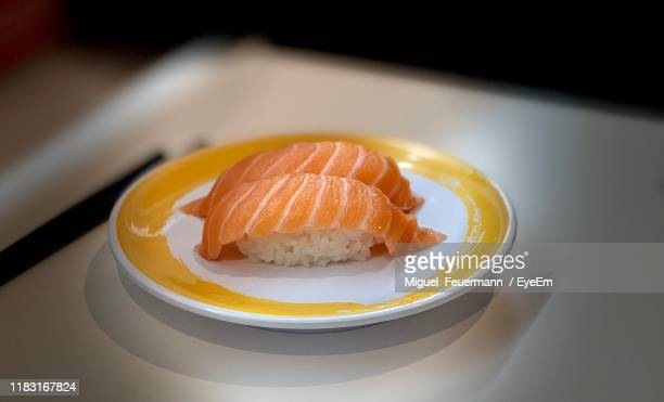 close-up of sushi in plate on table - nigiri stock pictures, royalty-free photos & images