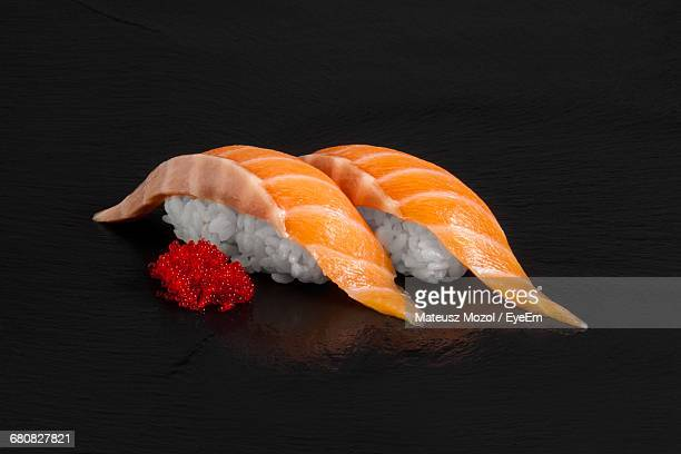 close-up of sushi on black background - nigiri stock pictures, royalty-free photos & images