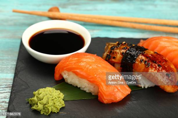 close-up of sushi on table - soy sauce stock pictures, royalty-free photos & images