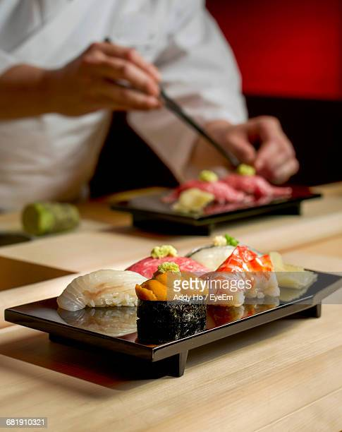 close-up of sushi on tray - pickled ginger stock pictures, royalty-free photos & images