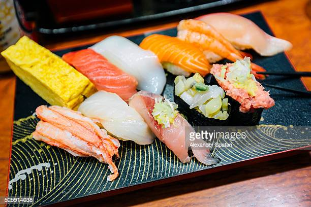 Close-up of sushi set on board