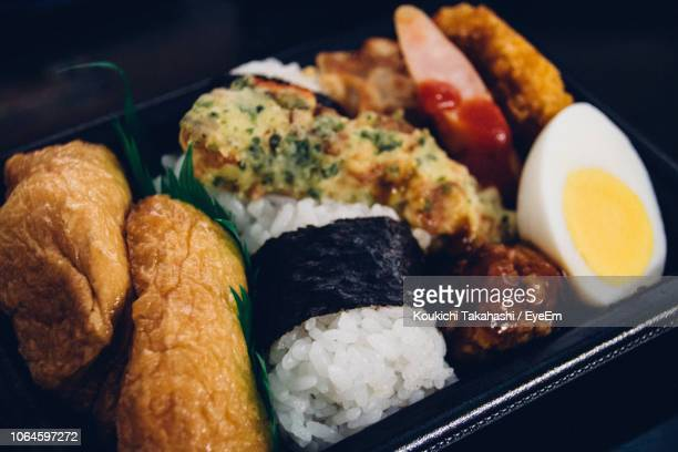 Close-Up Of Sushi With Meat And Egg In Container