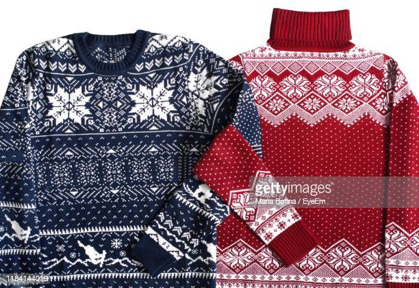 close-up of sweaters against white background - knitted stock pictures, royalty-free photos & images