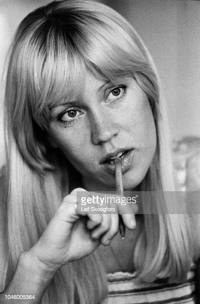 Closeup of Swedish Pop musician Agnetha Faltskog of the group ABBA as she bites a pen held in her hand Stockholm Sweden July 1977