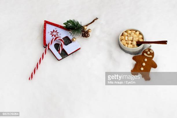 Close-Up Of Sweet Food On Fake Snow During Christmas