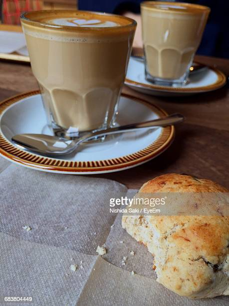 Close-Up Of Sweet Food With Cappuccino On Table