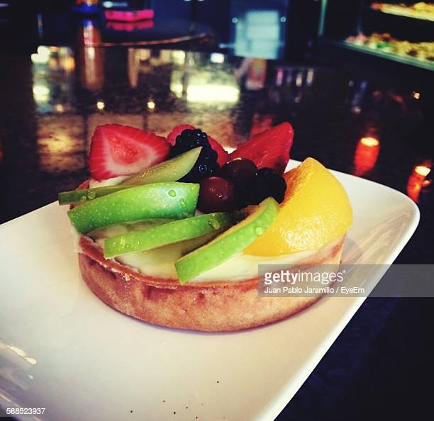 Close-Up Of Sweet Pie Served With Fruits On Plate