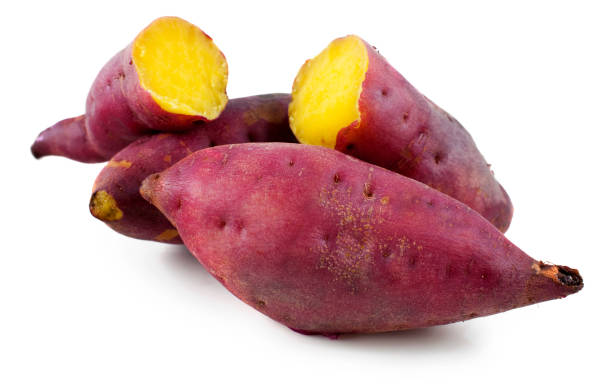 close-up of sweet potatoes against white background - さつまいも ストックフォトと画像