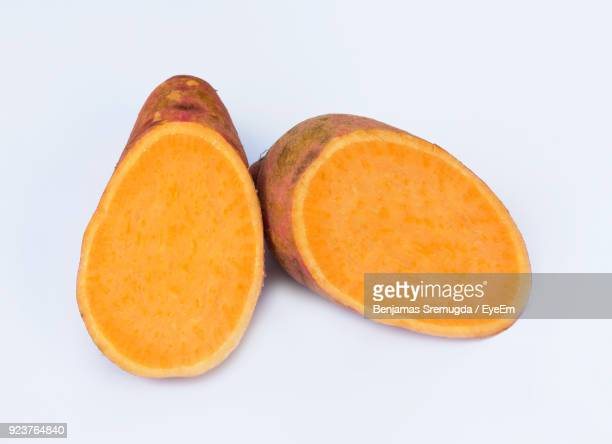 Close-Up Of Sweet Potatoes Over White Background