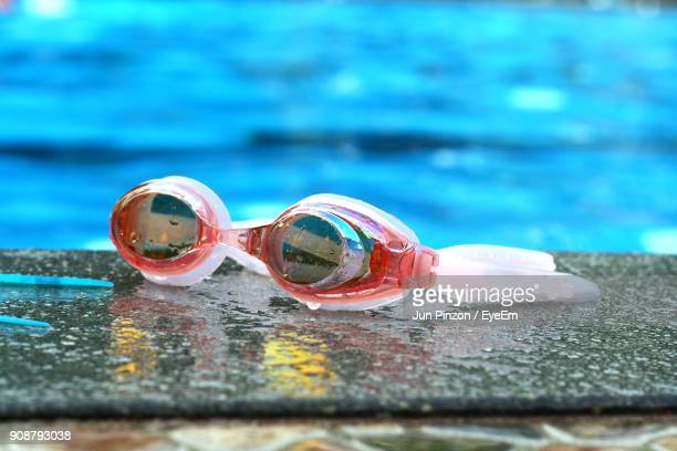 Close-Up Of Swimming Goggles On Poolside