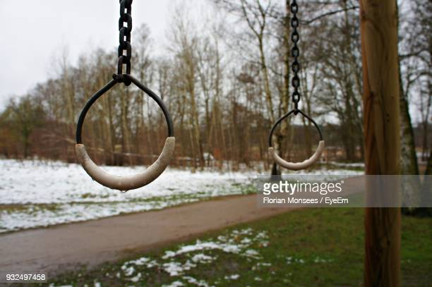 Close-Up Of Swing Hanging In Park