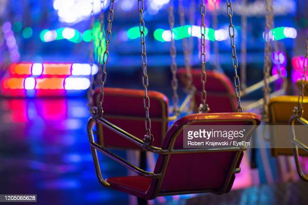 close-up of swing ride at night - night stock pictures, royalty-free photos & images