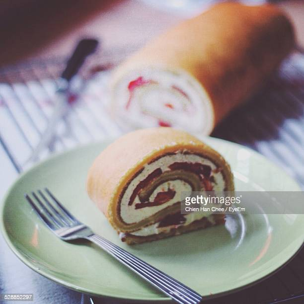 Close-Up Of Swiss Roll Cake Served On Table At Home