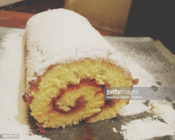 Close-Up Of Swiss Roll In Tray