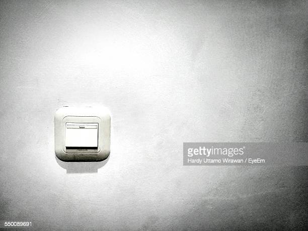 Close-Up Of Switch On Wall