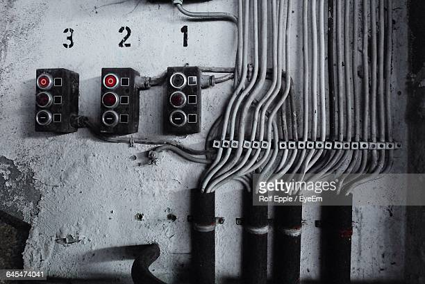 Close-Up Of Switchboards On Wall