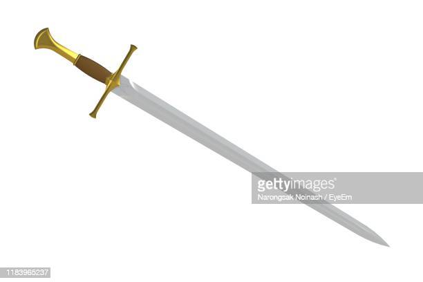 close-up of sword against white background - sword stock pictures, royalty-free photos & images