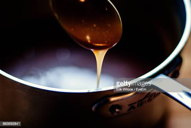 close-up of syrup on spoon - syrup stock pictures, royalty-free photos & images