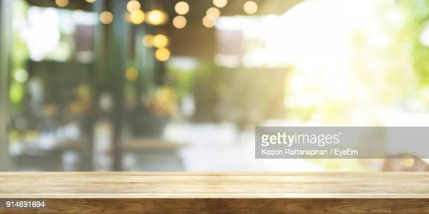 close-up of table against illuminated lights - table stock pictures, royalty-free photos & images