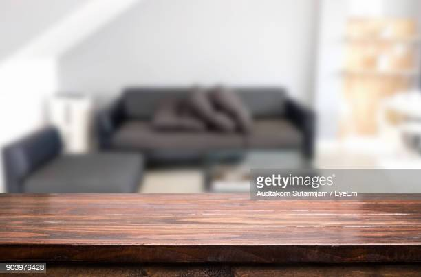 Close-Up Of Table Against Sofa At Office