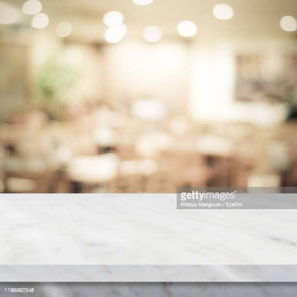 close-up of table in restaurant - focus on foreground stock pictures, royalty-free photos & images
