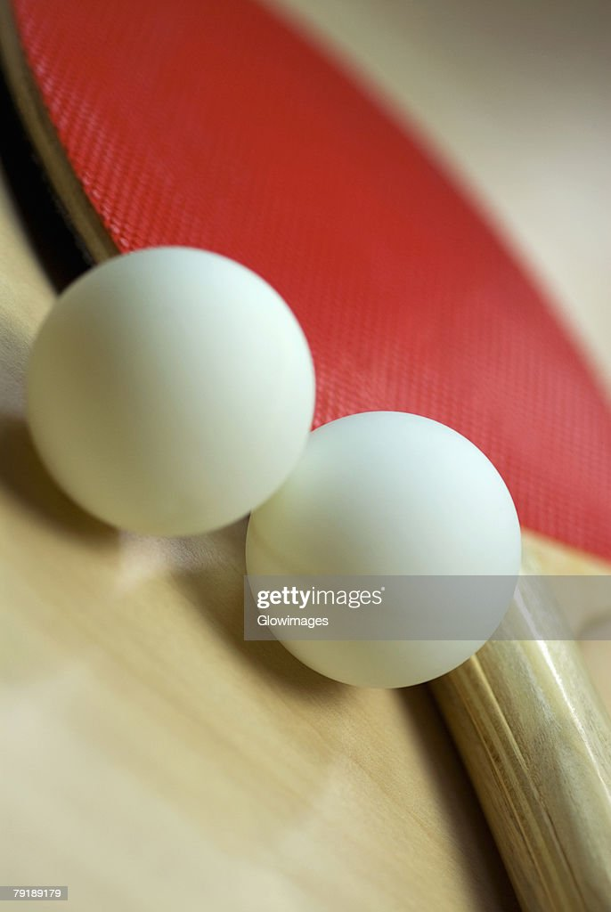 Close-up of table tennis balls with a table tennis racket : Stock Photo