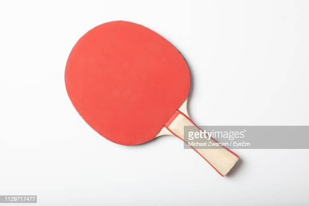 close-up of table tennis bat on white background - table tennis stock pictures, royalty-free photos & images
