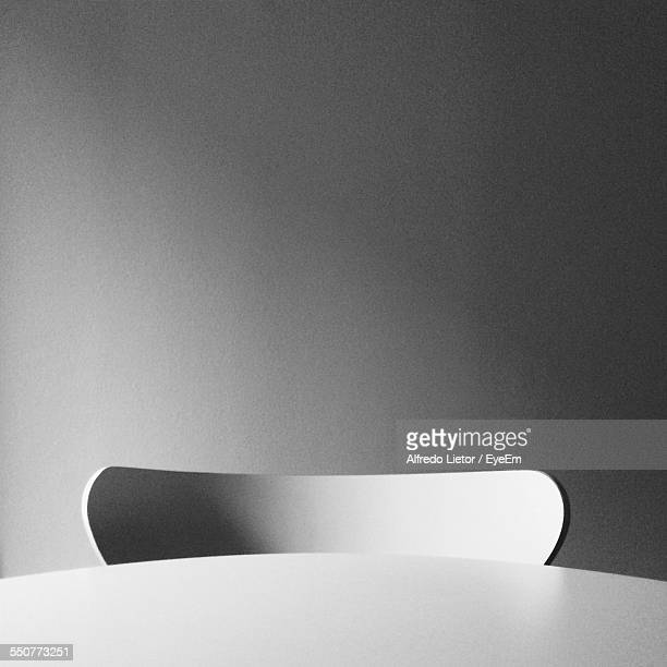Close-Up Of Table With Empty Chair