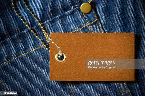 close-up of tag on jeans - label stock pictures, royalty-free photos & images