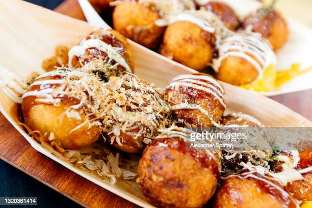 "close-up of takoyaki ""octopus balls"" japanese snack - takoyaki stock pictures, royalty-free photos & images"