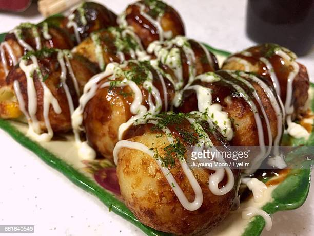 Close-Up Of Takoyaki Served In Plate On Restaurant Table