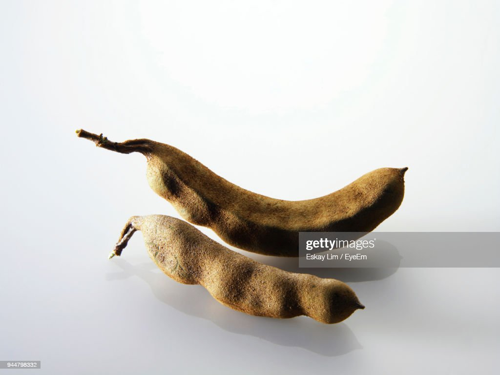 Close-Up Of Tamarind Against White Background : Stock Photo