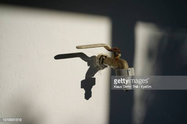 Close-Up Of Tap On Wall