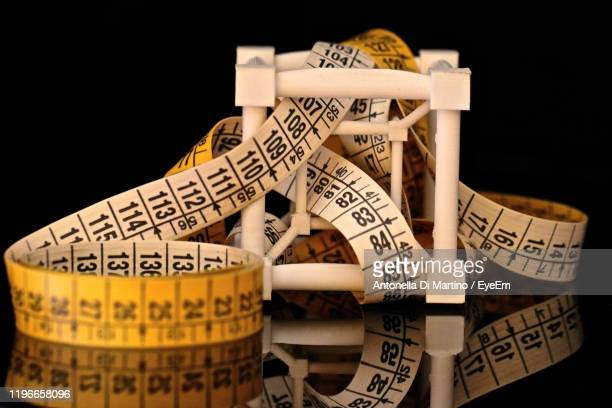 close-up of tape measure on table - antonella di martino foto e immagini stock