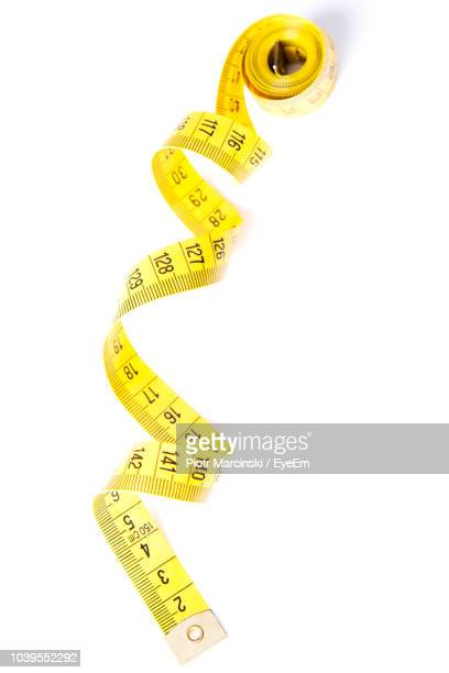 Close-Up Of Tape Measure On White Background