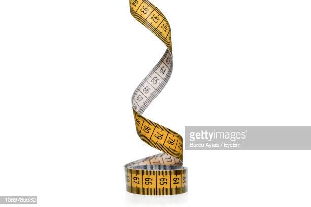 close-up of tape measure on white background - measuring tape stock photos and pictures