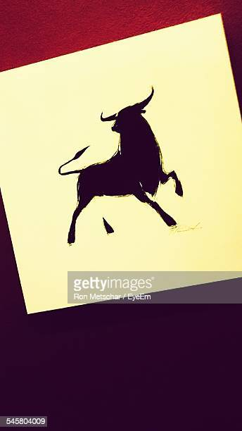 Close-Up Of Taurus Sign On Table
