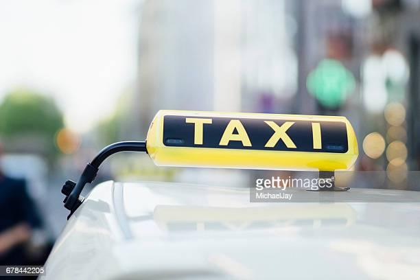 Close-Up Of Taxi Sign