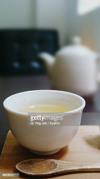 Close-Up Of Tea And Kittle On Table