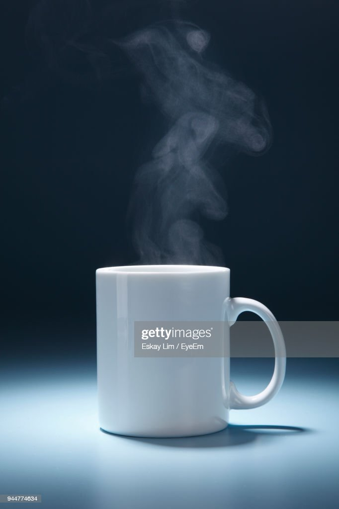 Close-Up Of Tea Cup Against Black Background : Stock Photo
