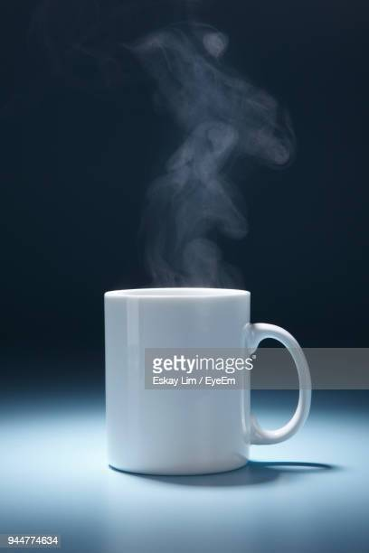 close-up of tea cup against black background - steam stock pictures, royalty-free photos & images