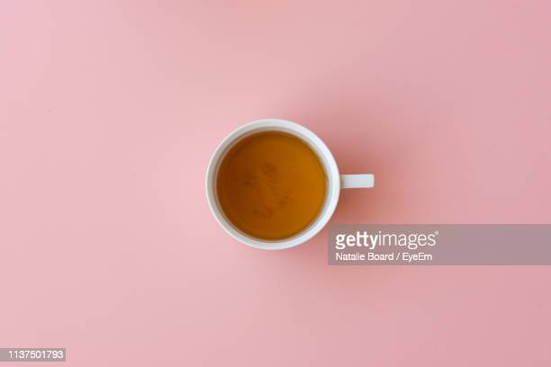 close-up of tea cup against pink background - tea cup stock pictures, royalty-free photos & images