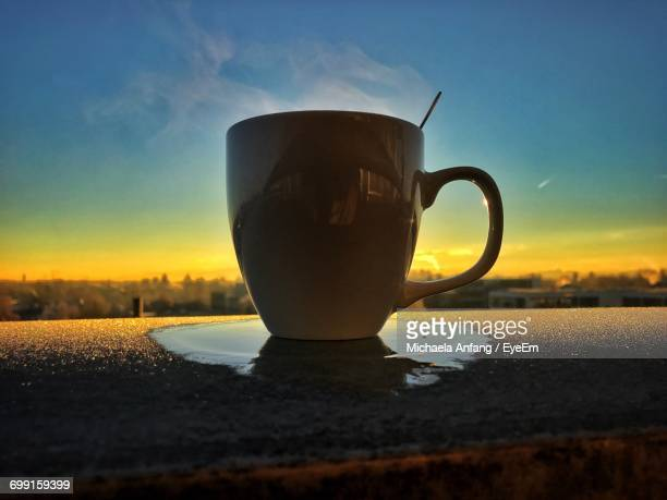 close-up of tea cup against sky - anfang stock pictures, royalty-free photos & images