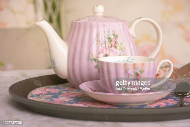 close-up of tea cup on table - floral pattern stock pictures, royalty-free photos & images