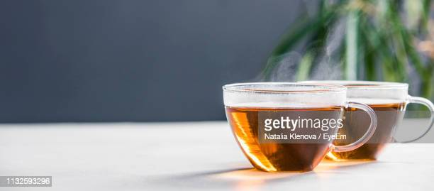 close-up of tea cups on table - black tea stock pictures, royalty-free photos & images