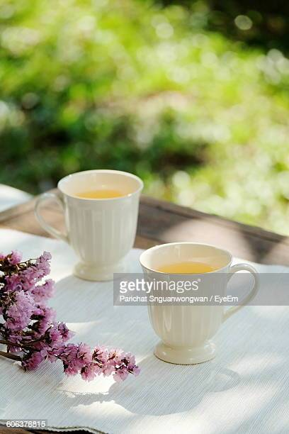 Close-Up Of Tea Cups With Pink Flowers On Table