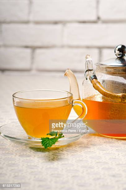 Close-Up Of Tea In Cup And Teapot On Table